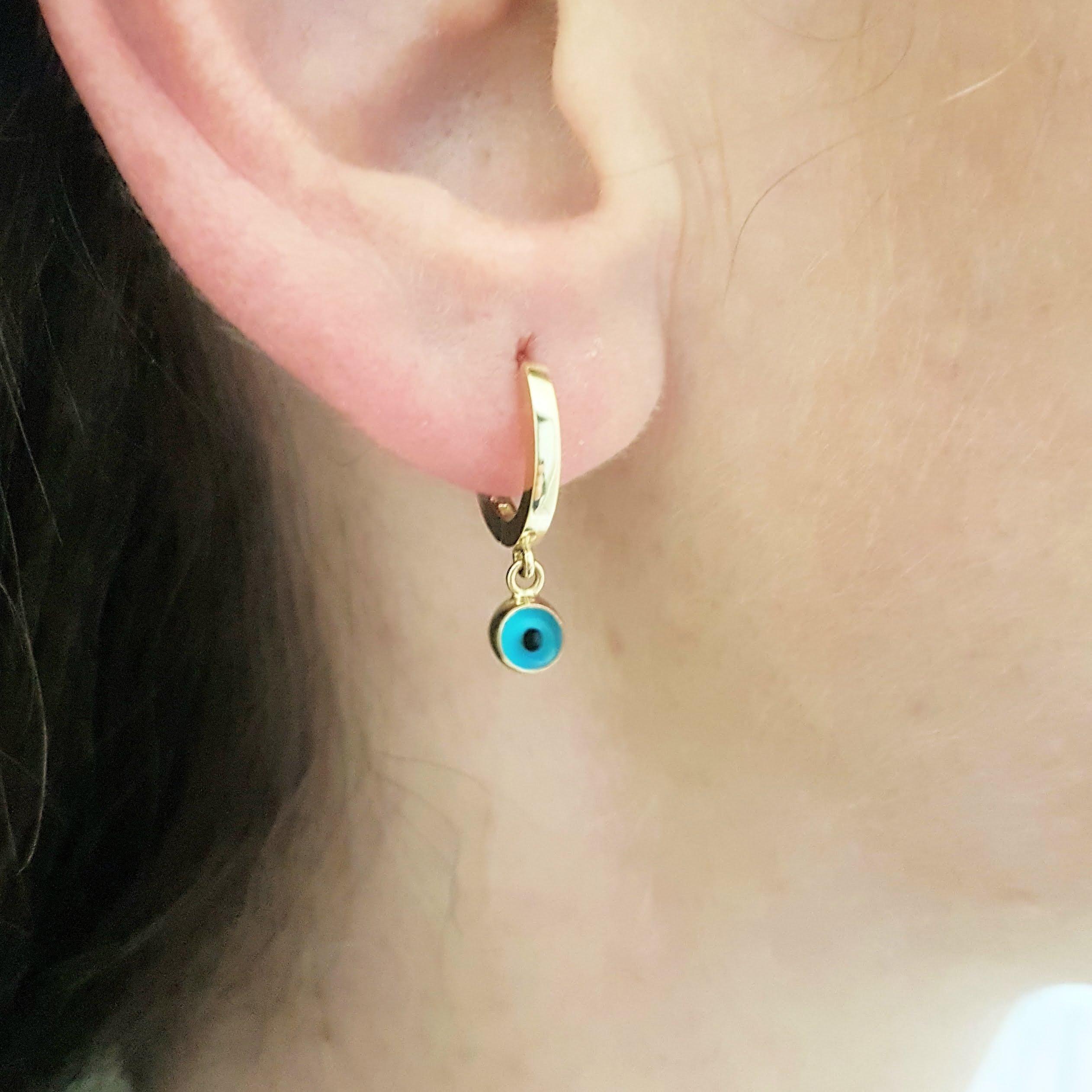 Trendy evil eye dangle earrings